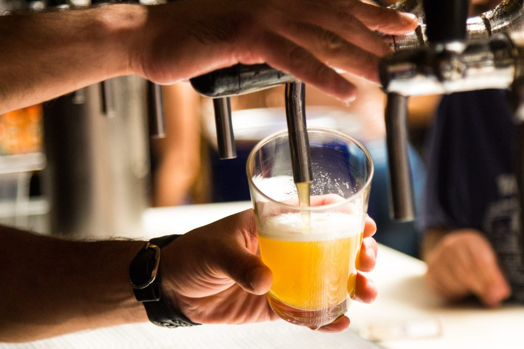 Bartender Pouring A Draft Beer