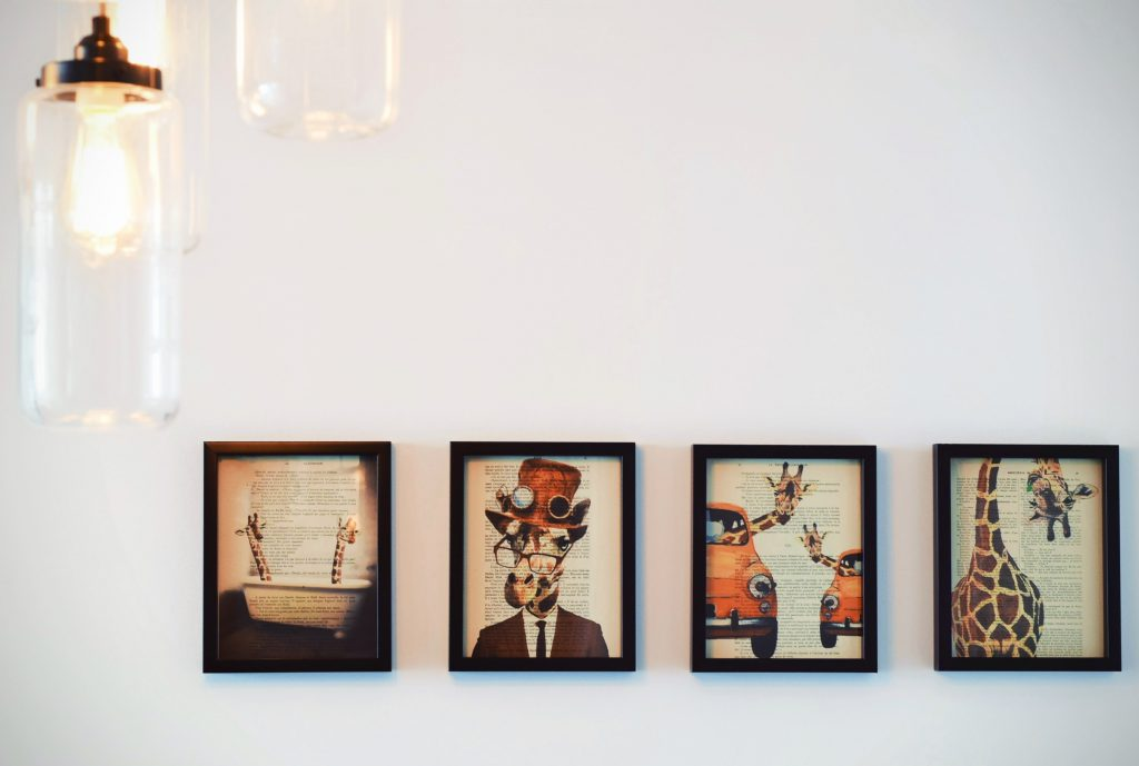 Four Quirky Giraffe Paintings on Wall