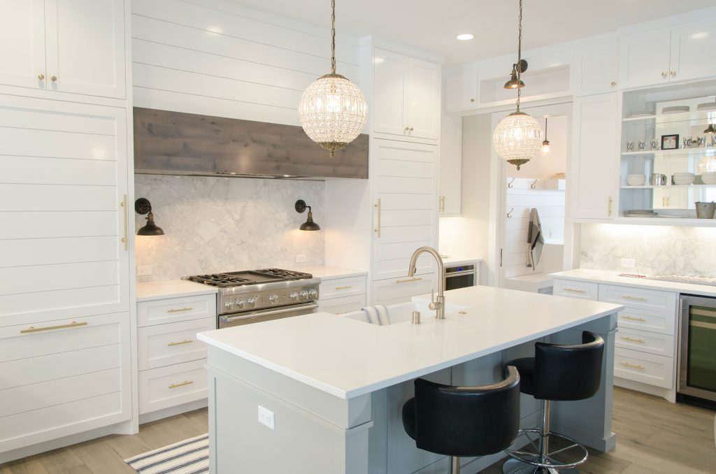 beautiful bright white kitchen with pendant lights over island