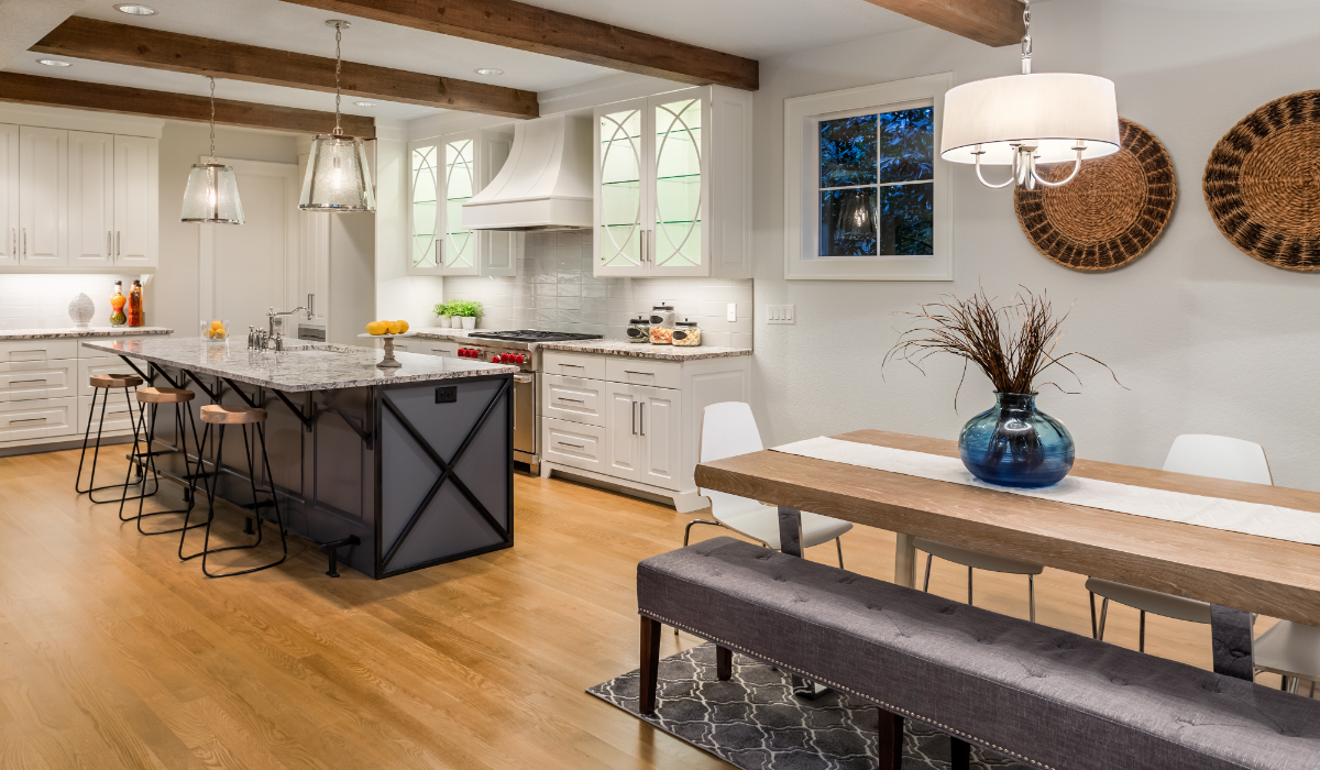 beautiful dining room and kitchen in luxury home with hardwood floors