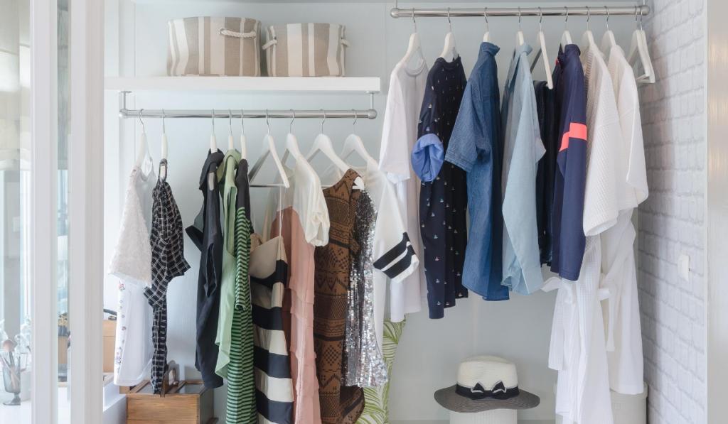 clean white organized bedroom closet