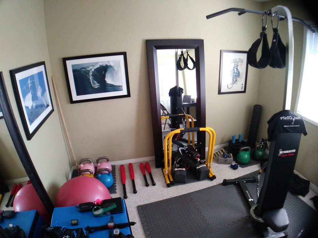 home gym fitness equipment in spare bedroom