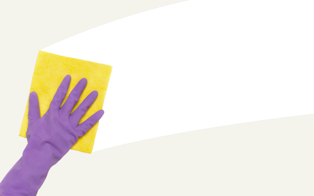 hand with purple glove and sponge cleaning streak from wall