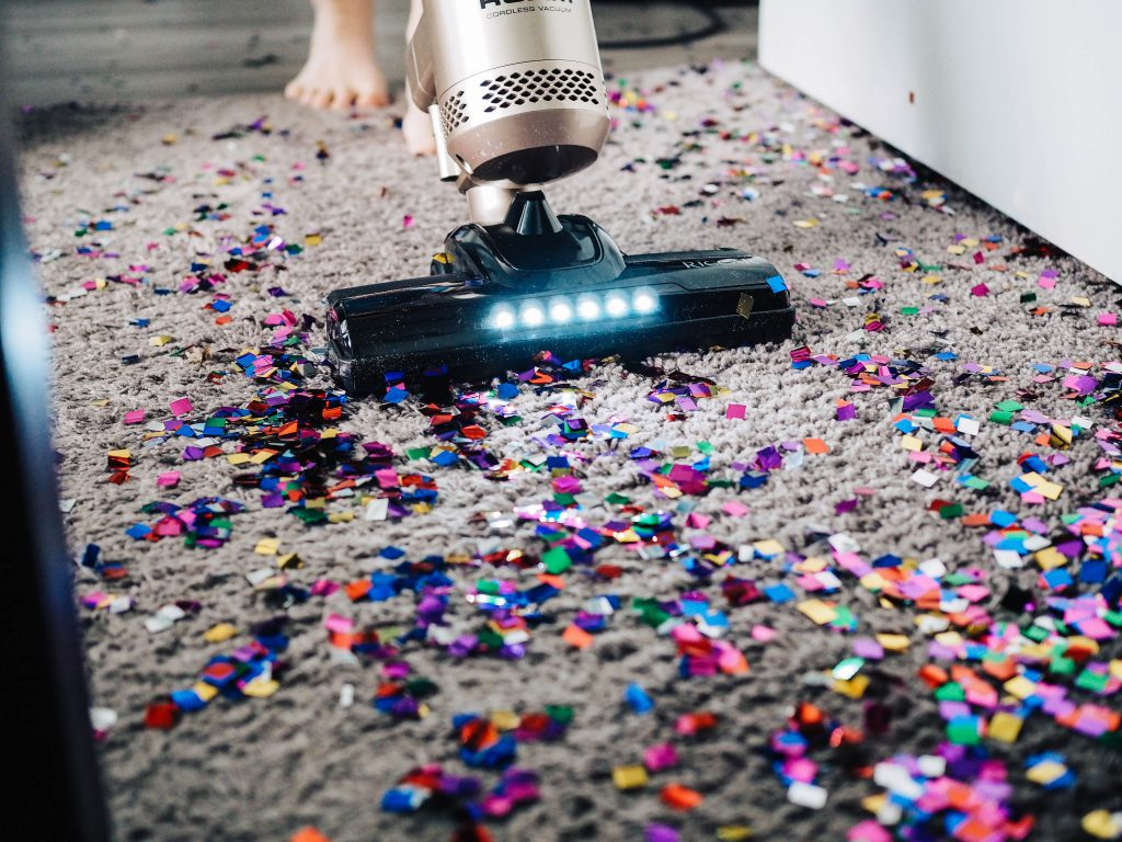 vacuuming confetti out of carpet