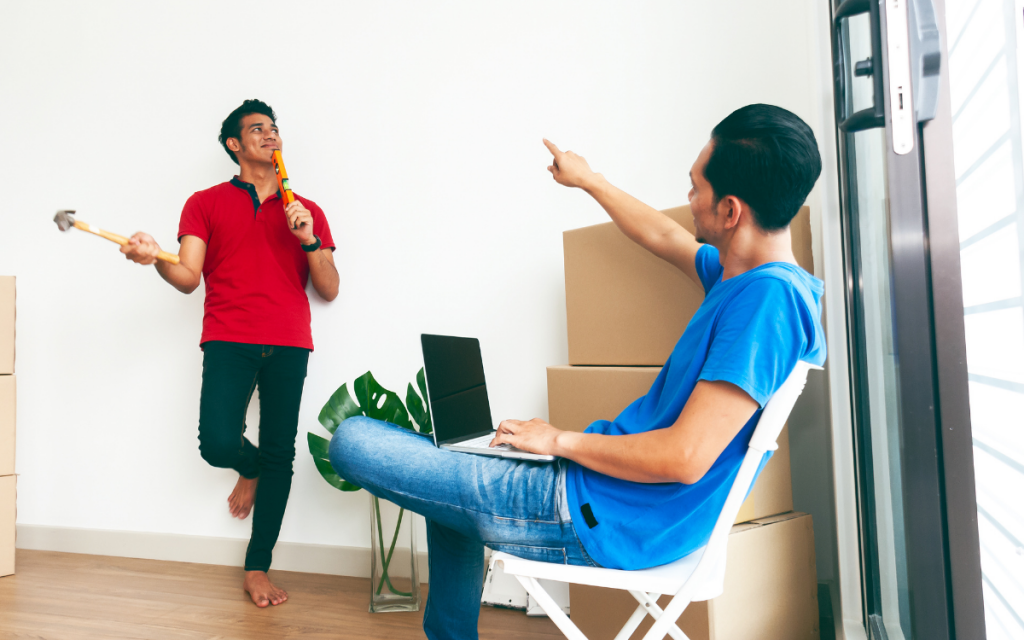 two-men-moving-in-inspecting-apartment