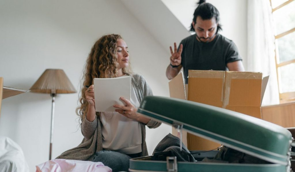 couple making a list of moving out stuff