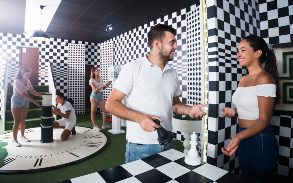 couple with group in an escape room