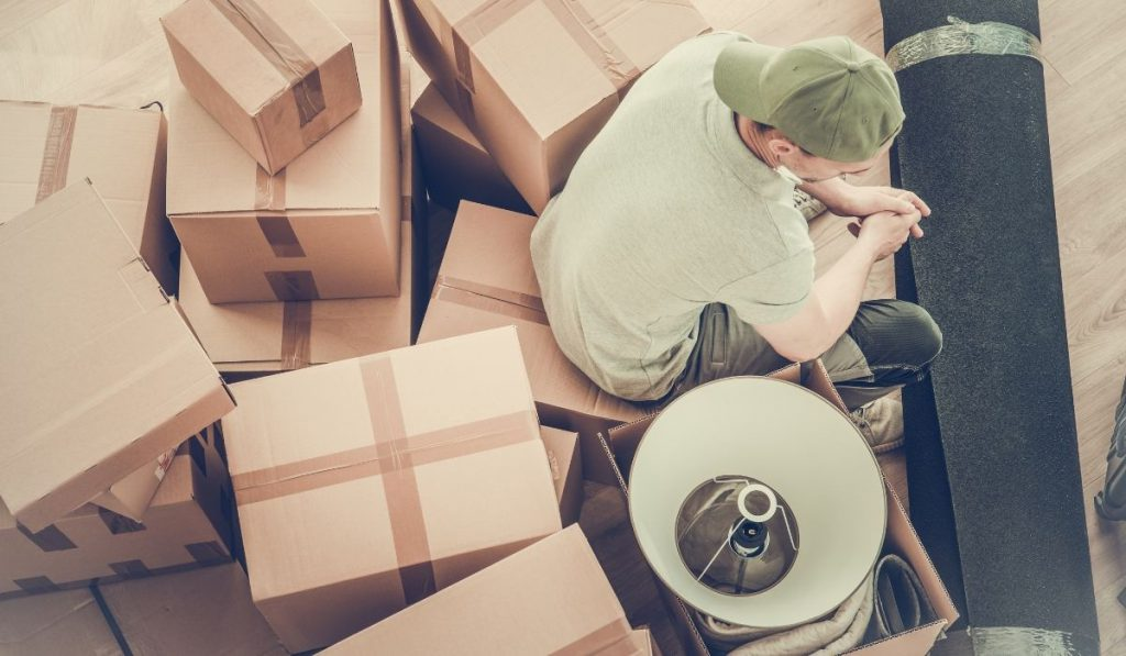 man sitting on top of the boxes