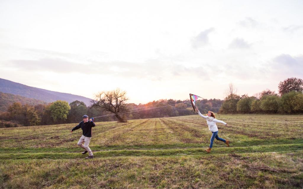 senior couple flying a kite