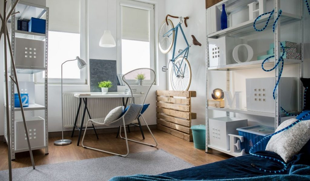 micro apartment with a steel welded storage rack; white and blue colors