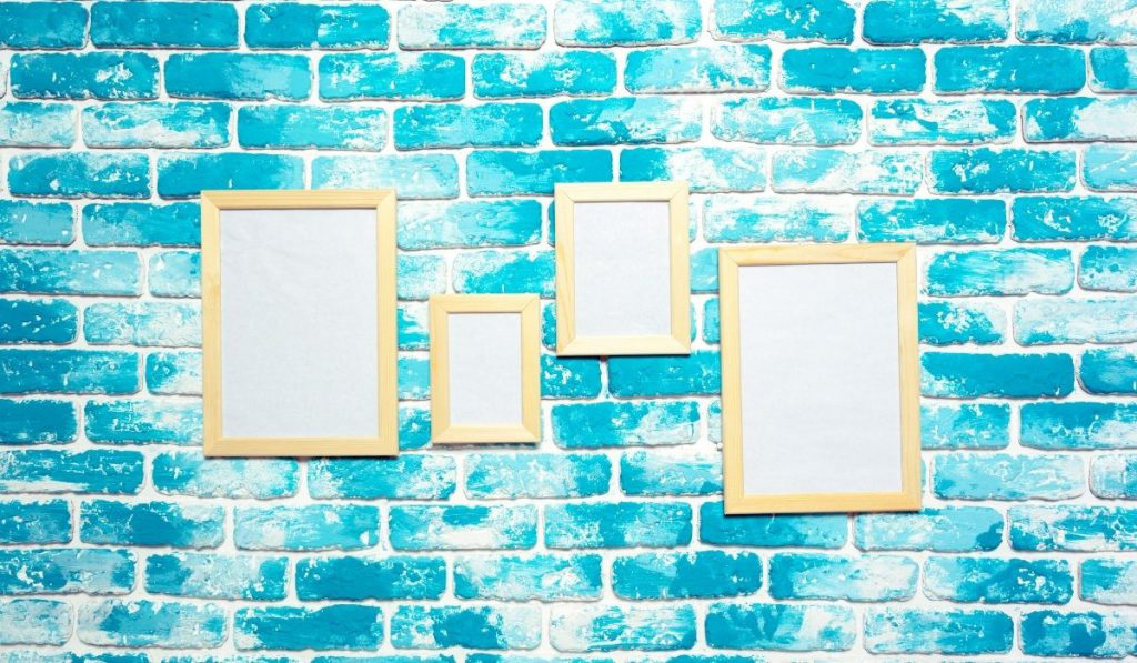 wall painted in aqua and white with picture frames
