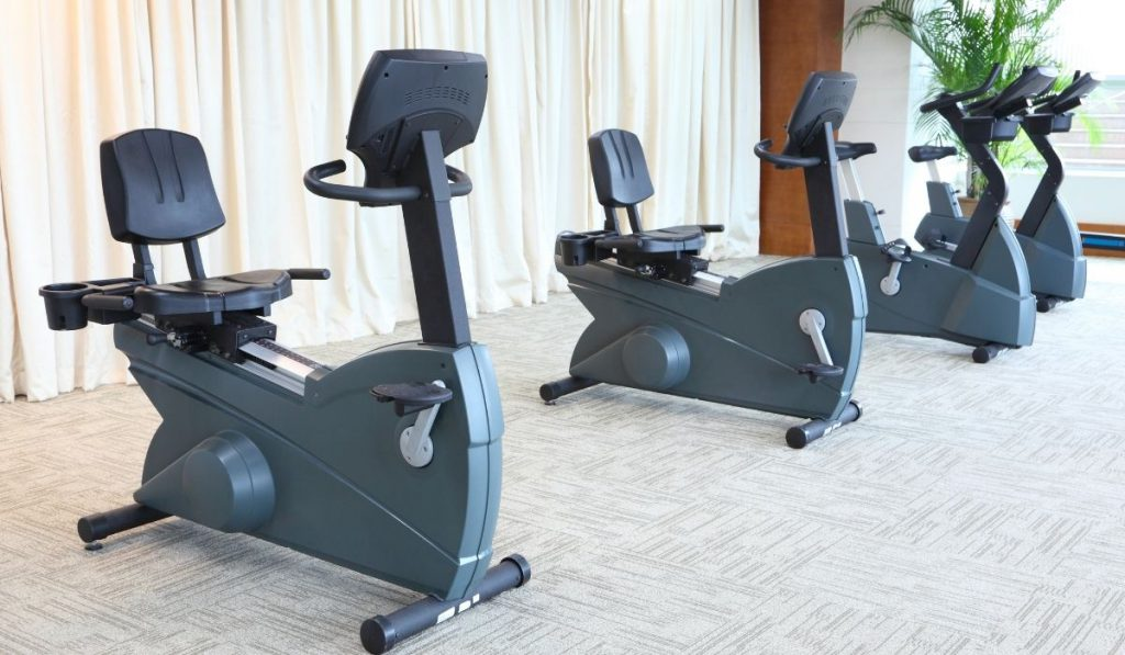4 gray stationary bikes indoor
