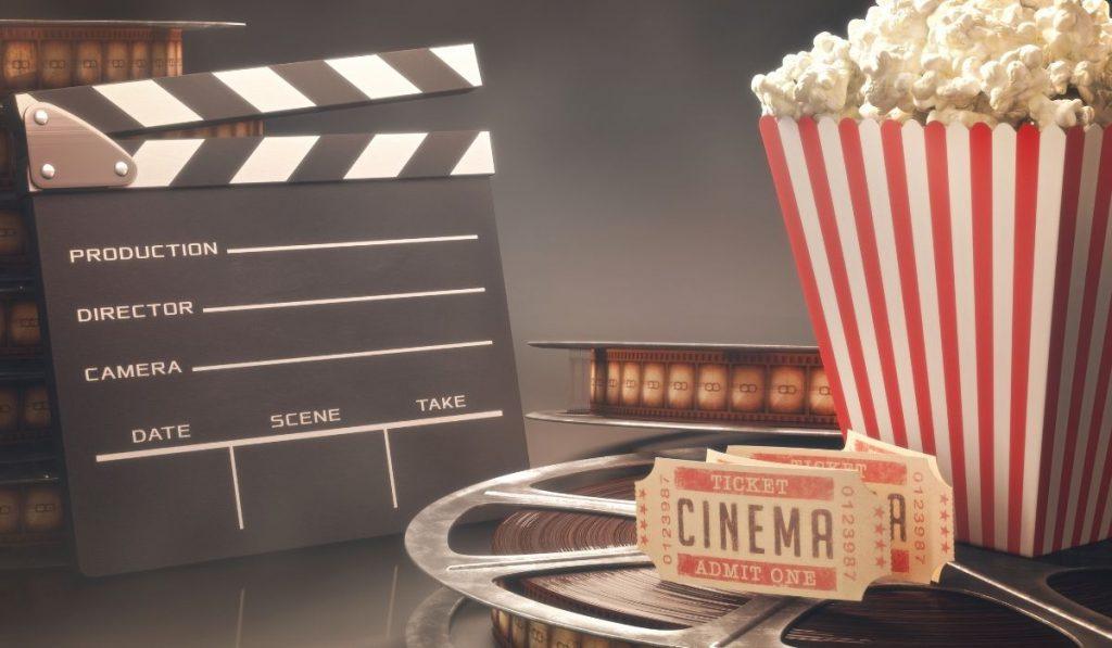 clapper board film popcorn and tickets
