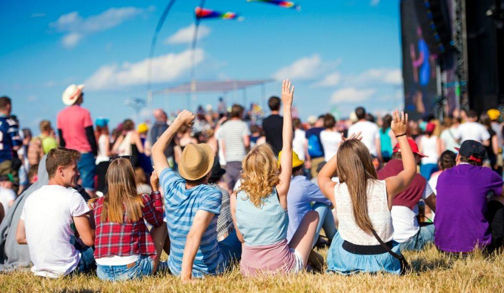 group of friends enjoying the music festival